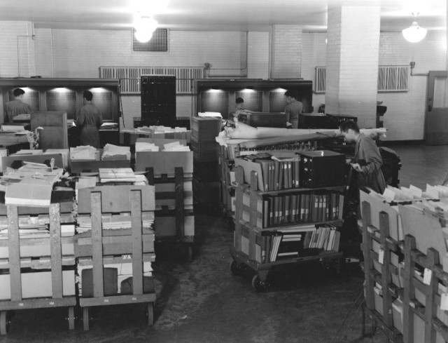 64-NA-250 (NAID 12168722) Records of the National Recorvery Administration in the Receiving Room, Oct. 1940