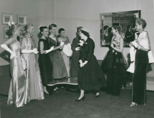 """Oct. 18, 1955; Mrs. Mamie Eisenhower bids adieu to the Daniel and Fisher fashion show models at the Fitzsimons Army Hospital's Officer's Wives Club."""