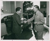 """Major General Martin E. Griffin greets Vice President Richard Nixon as he arrives at Fitzsimons Army Hospital to call on President Eisenhower, October 8, 1955."""