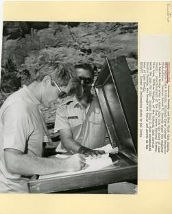 Senator Kennedy signing the register at Rainbow Bridge.