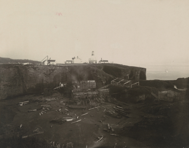 Image of Light station and Indian canoes at Cape Flattery.