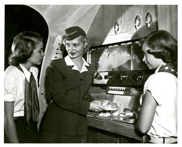 A photograph of three stewardesses in training.